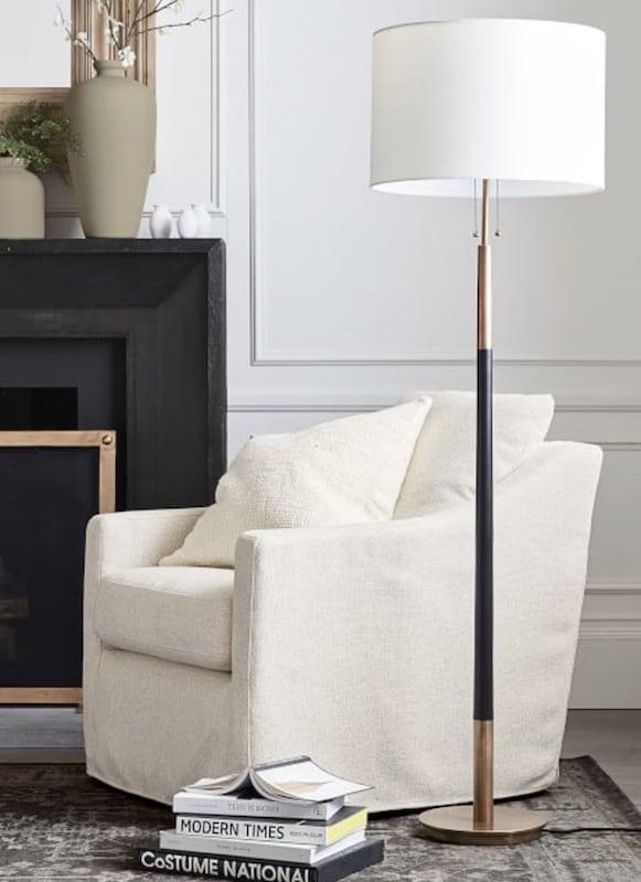 floor lamp beside a chair