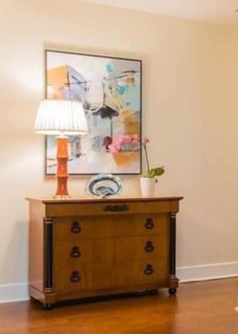 art hung above a dresser